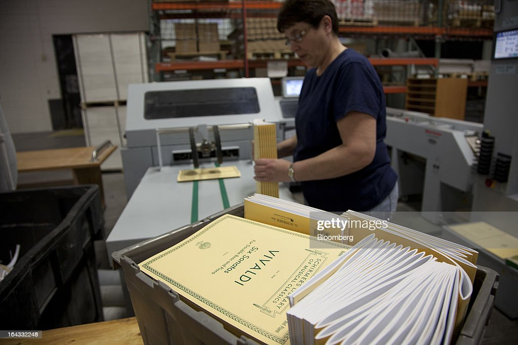 Employee Donna Gady counts and stacks sheet music books at the Hal Leonard Corp. printing facility in Winona, Minnesota, U.S., on Friday, March 22, 2013. Hal Leonard is the world's largest print music publisher, distributing more than 200,000 titles to over 65 countries. Photographer: Ariana Lindquist/Bloomberg via Getty Images