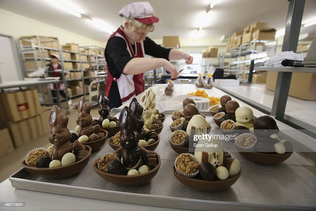 Employee Doreen Krohe packs chocolate Easter bunnies and eggs at the production facility at Confiserie Felicitas chocolates maker on April 9, 2014 in Hornow, Germany. Easter is among the busiest times of year for the chocolatier, which produces Easter bunnies and eggs in a wide variety of sizes and styles. Founded by Belgian expats Goedele Matthyssen and Peter Bientsman the company will soon celebrate its 21st year.