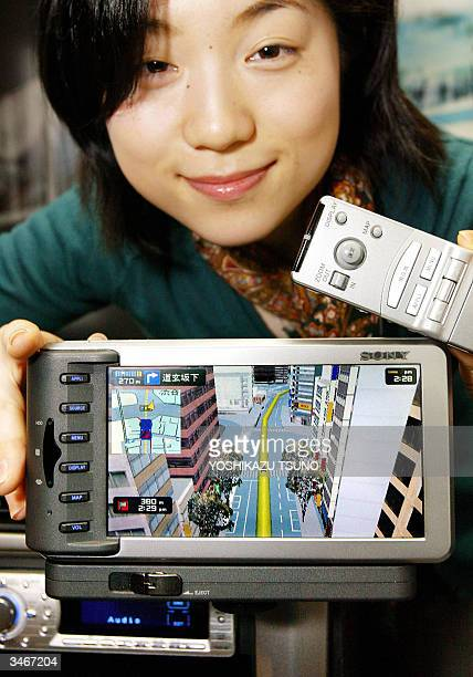 Employee for Japanese electronics giant Sony Sachiko Negishi displays the new HDD car navigation system 'NVXYZ777' which can display animated 3D CG...