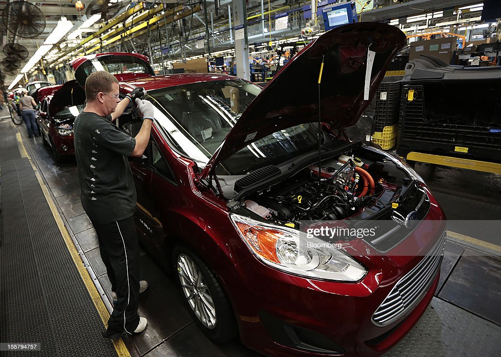 employee gary roberts works on a ford motor co c max energi plug in. Cars Review. Best American Auto & Cars Review