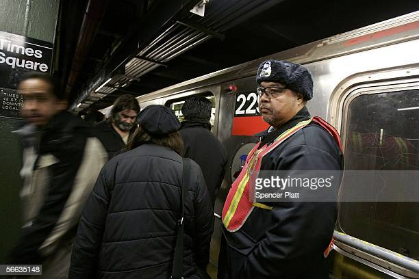 MTA employee Gerard Lafontant works on the number 9 line at 42nd Street January 20 2006 in New York City New York's transit workers narrowly rejected...