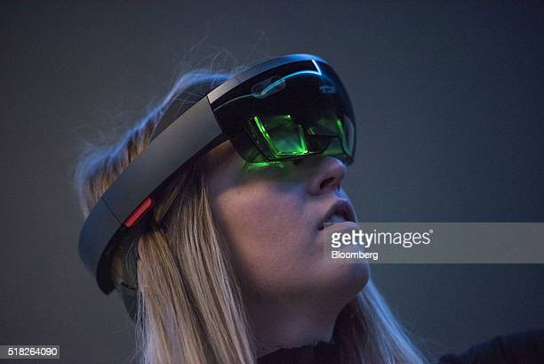 Employee Gillian Pennington demonstrates the Microsoft Corp HoloLens augmented reality viewer at the Microsoft Developers Build Conference in San...