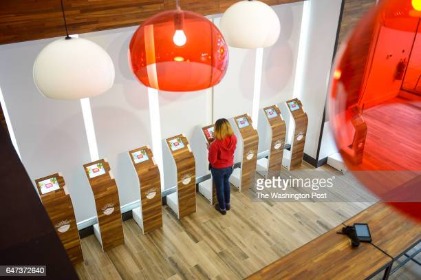 Employee Gina Hall demonstrates the touchscreen kiosk at Easty a new restaurant on Pennsylvania Ave on February 21 2017 in Washington DC