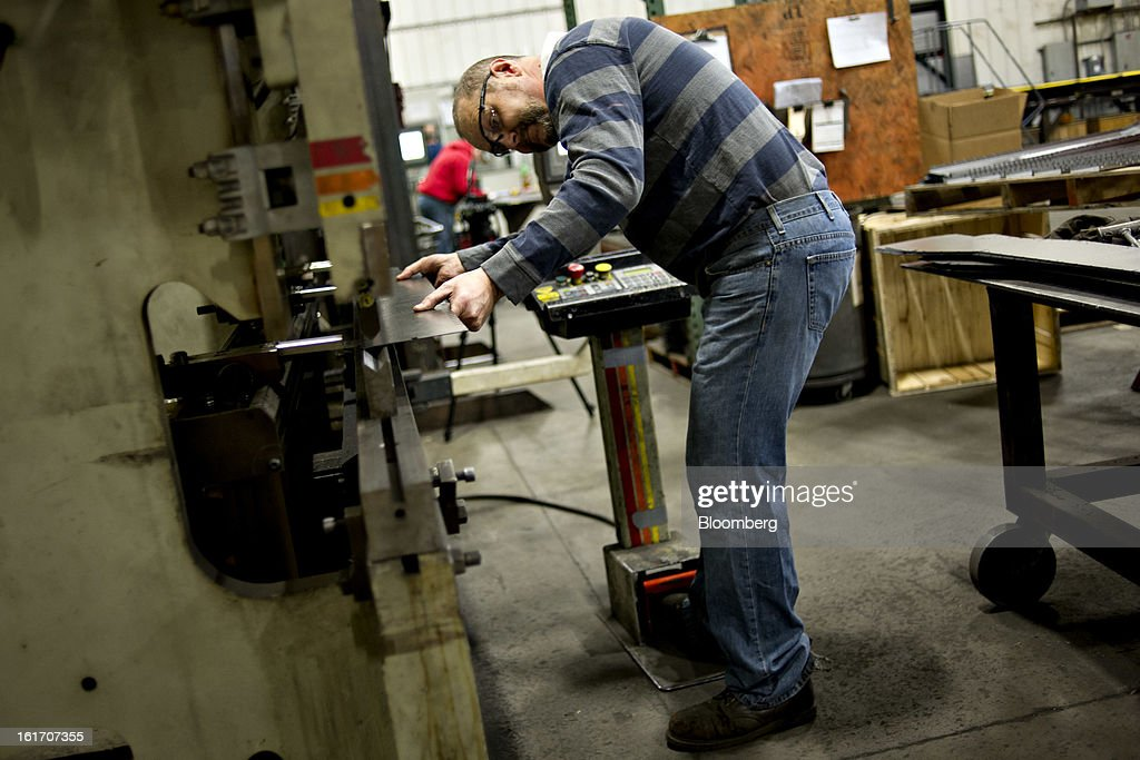 Employee Greg Shaffer lines up a part as he works at a press break at the Giese Manufacturing Co. in Dubuque, Iowa, U.S., on Thursday, Feb. 14, 2013. The U.S. Federal Reserve is schedule to release industrial productions figures on Feb. 15. Photographer: Daniel Acker/Bloomberg via Getty Images