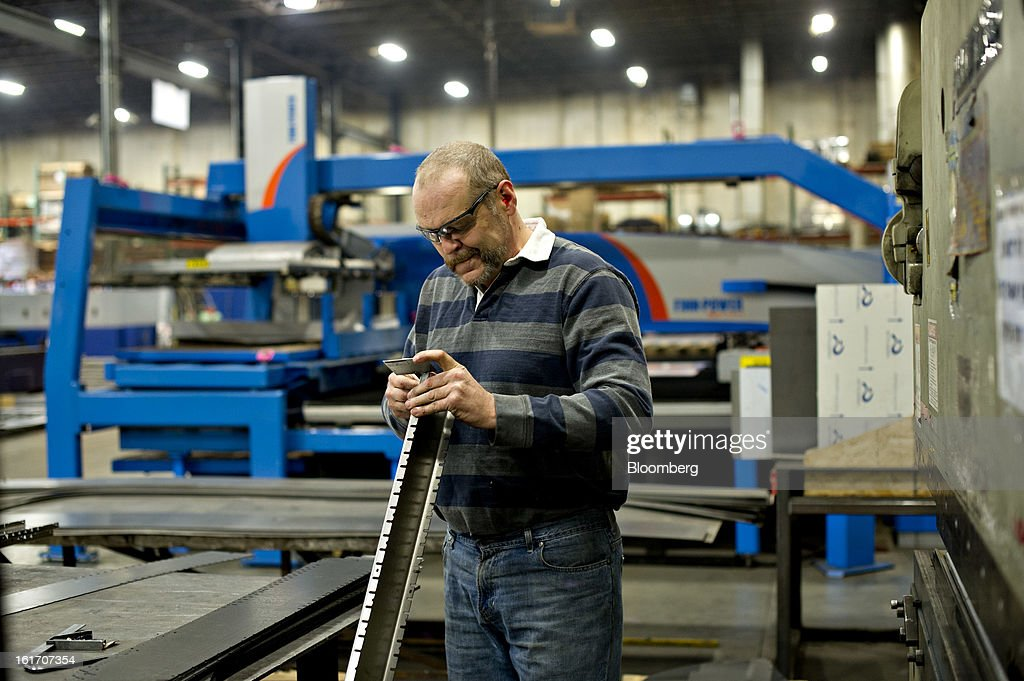 Employee Greg Shaffer uses a gauge to check the accuracy of a bend as he works at a press break at the Giese Manufacturing Co. in Dubuque, Iowa, U.S., on Thursday, Feb. 14, 2013. The U.S. Federal Reserve is schedule to release industrial productions figures on Feb. 15. Photographer: Daniel Acker/Bloomberg via Getty Images