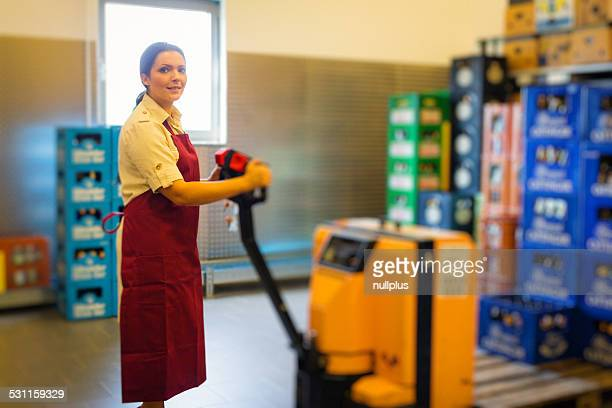 employee in supermarket warehouse