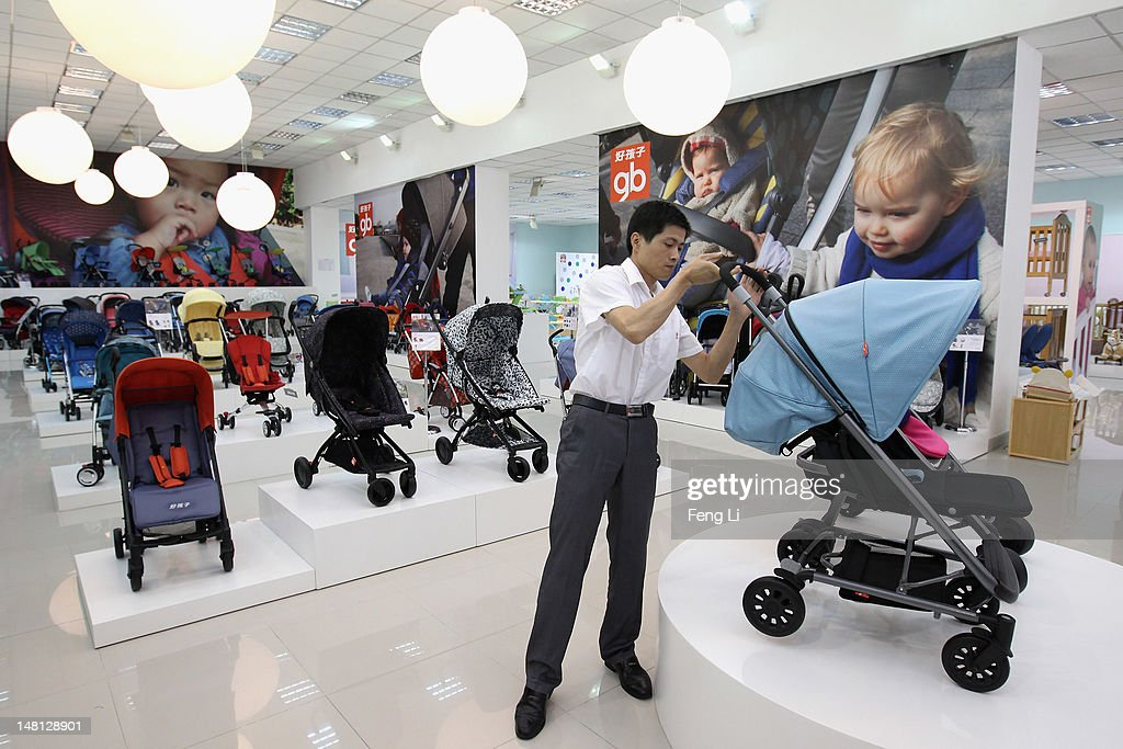 A employee introduces the stroller at the exhibition hall of Goodbaby Group Co., Ltd. on July 6, 2012 in Kunshan of Jiangsu Province, China. Chinese Premier Wen Jiabao said Tuesday that stabilizing economic growth is the most pressing matter currently facing China. China's central bank's sudden cut in the benchmark interest rates for the second time in a month confirmed the pessimistic view of the current economic situation.