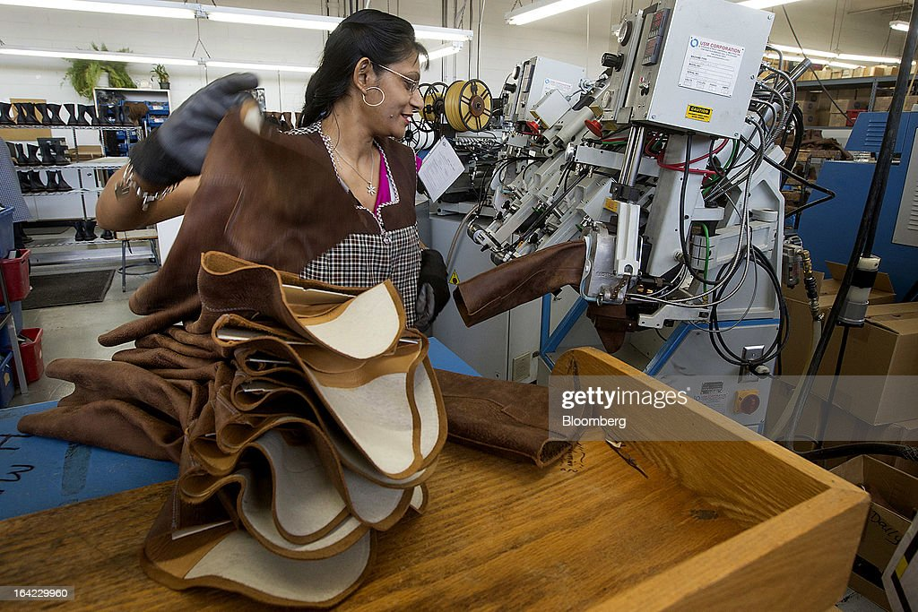 Employee Jenny Singh attaches the upper parts of boots to bases at the Roots Ltd. manufacturing facility in Toronto, Ontario, Canada, on Wednesday, March 20, 2013. Roots Ltd., a Canadian clothing and lifestyle products retailer, manufactures footwear, leather goods, active athletic wear, yoga wear, accessories and home furnishings. Photographer: Norm Betts/Bloomberg via Getty Images