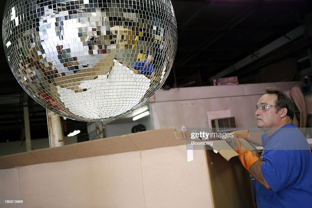 Employee Jerry Casey holds a four foot disco ball box at the Omega National Products manufacturing facility in Louisville, Kentucky, U.S., on Tuesday, Sept. 10, 2013. The U.S. Federal Reserve is scheduled to release industrial production figures on Sept. 16. Photographer: Luke Sharrett/Bloomberg via Getty Images