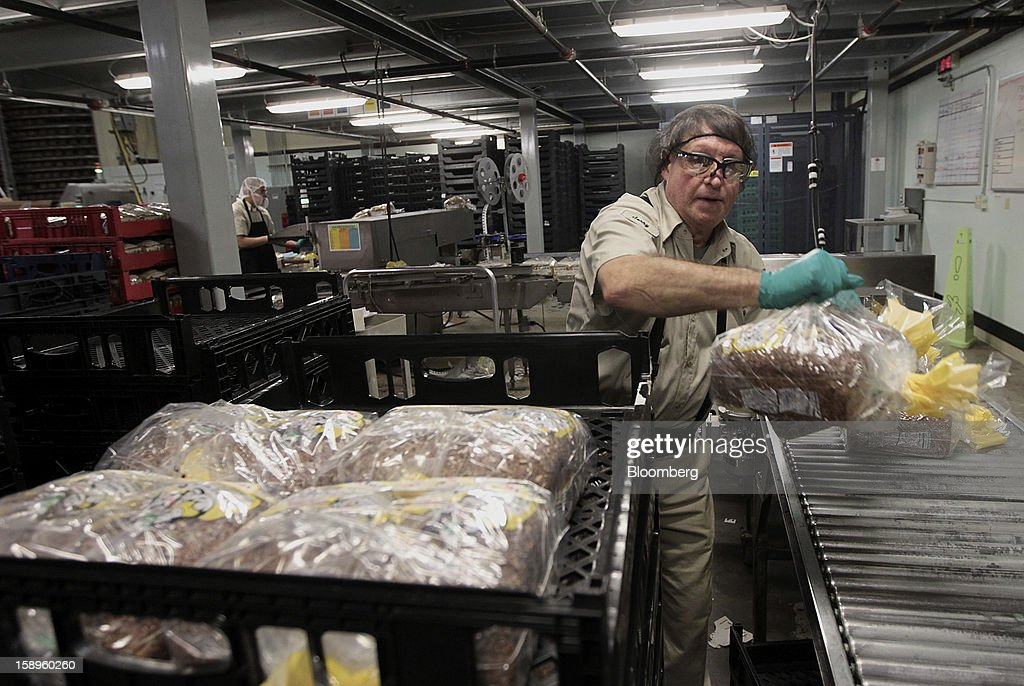 Employee Jerry Kelso packs freshly baked loaves of Dave's Killer Bread for shipment at the company's bakery in Milwaukie, Oregon, U.S., on Friday, Jan. 4, 2013. Goode Partners, a private equity firm specializing in growth investments in the branded consumer products sectors, has purchased a fifty percent stake in Dave's Killer Bread which will help the company expand into new markets around the country. Photographer: Natalie Behring/Bloomberg via Getty Images