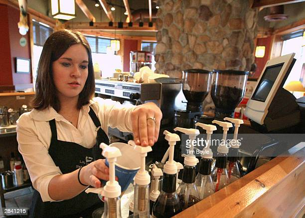 Employee Jessica Brantner adds 'Splenda' into a cup as she prepares a new 'Skinny'Bou Latte' in a Caribou Coffee store January 2 2004 in Mount...