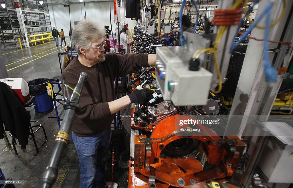 Employee Joe Boecker assembles an 2.0 liter ecoboost engines on the production line at the Ford Motor Co. Cleveland Engine Plant in Brook Park, Ohio, U.S., on Thursday, Feb. 21, 2013. Ford Motor Co. said it will invest $200 million to make four-cylinder engines at the plant starting in late 2014 as the second-largest U.S. automaker equips an increasing number of models with smaller, more fuel-efficient powertrains. Photographer: David Maxwell/Bloomberg via Getty Images