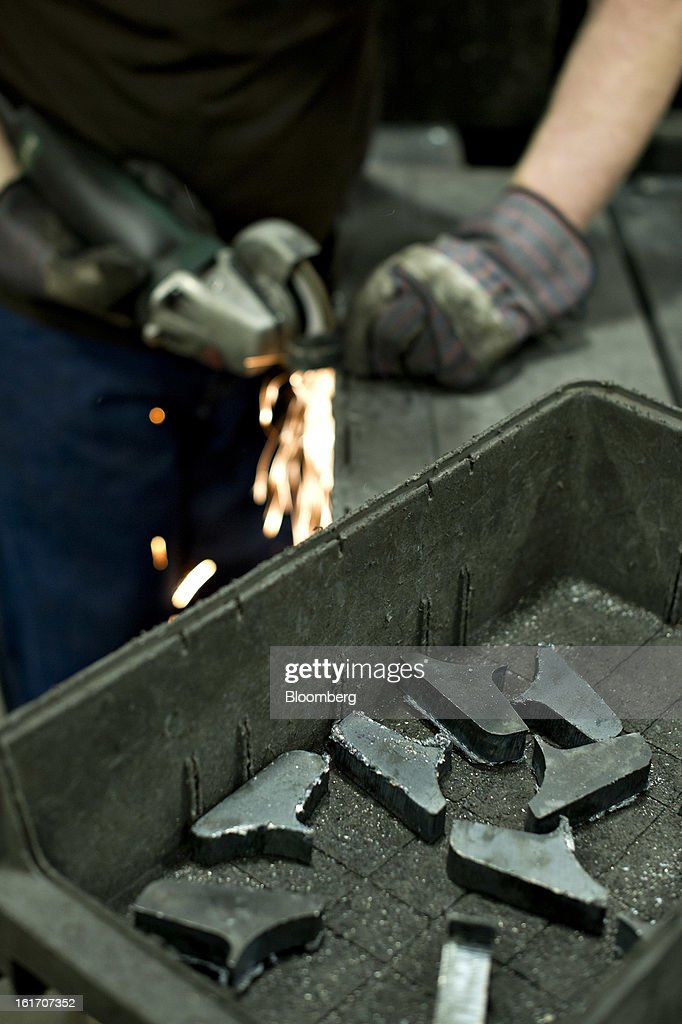 Employee Jon Goerdt uses a grinder at the Giese Manufacturing Co. in Dubuque, Iowa, U.S., on Thursday, Feb. 14, 2013. The U.S. Federal Reserve is schedule to release industrial productions figures on Feb. 15. Photographer: Daniel Acker/Bloomberg via Getty Images