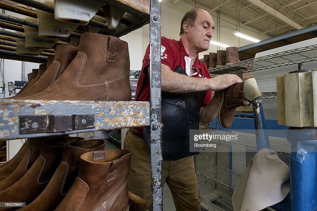 Employee Kahoren Barkhordarian completes a boot at the Roots Ltd. manufacturing facility in Toronto, Ontario, Canada, on Wednesday, March 20, 2013. Roots Ltd., a Canadian clothing and lifestyle products retailer, manufactures footwear, leather goods, active athletic wear, yoga wear, accessories and home furnishings. Photographer: Norm Betts/Bloomberg via Getty Images