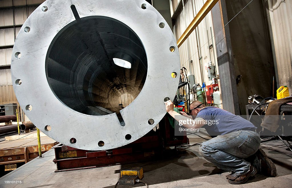 Employee Kevin Wertz lowers a section of a steel pole using an overhead crane at the Rohn Products LLC manufacturing facility in Peoria, Illinois, U.S., on Wednesday, Oct. 31, 2012. Manufacturing in the U.S. probably expanded in October at a slower pace, indicating the industry is providing little thrust for the expansion, economists said before a report today. Photographer: Daniel Acker/Bloomberg via Getty Images