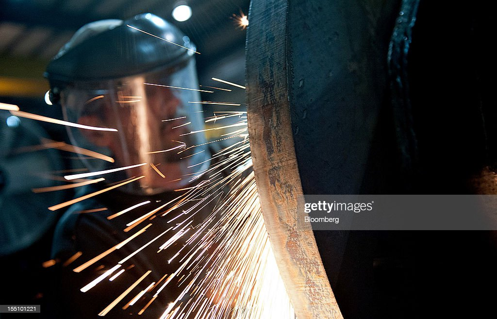 Employee Kirk Carpenter uses a grinding wheel as he assembles the bottom of a steel pole at the Rohn Products LLC manufacturing facility in Peoria, Illinois, U.S., on Wednesday, Oct. 31, 2012. Manufacturing in the U.S. probably expanded in October at a slower pace, indicating the industry is providing little thrust for the expansion, economists said before a report today. Photographer: Daniel Acker/Bloomberg via Getty Images