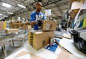 Employee Lamar Roby prepares shipping orders at Amazon's San Bernardino Fulfillment Center October 29 2013 in San Bernardino California Amazon's 1...