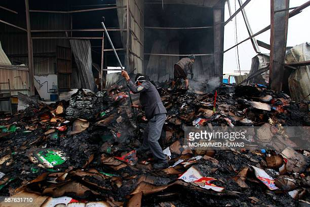 Employee look through the damage at the AlAqel food factory that makes potato chips in Yemen's rebelheld capital Sanaa after it was hit by a Saudiled...