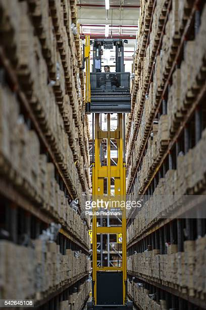 Employee looks for a part at the CASE's distribution center line Sorocaba Brazil on Wednesday September 18th 2013