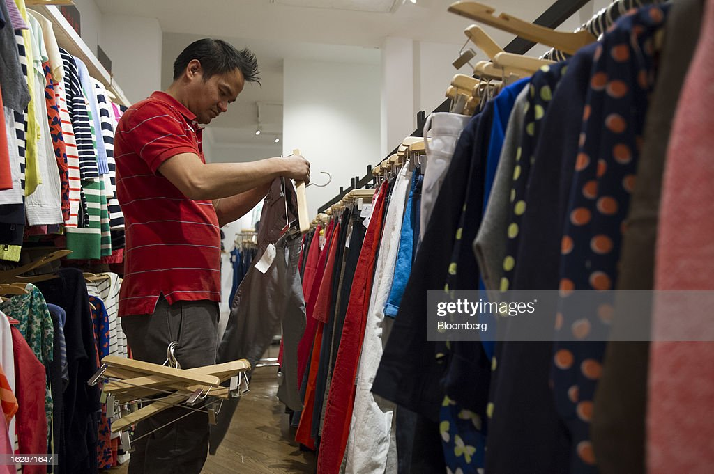 Employee Louie Reside prepares clothes for display at a Gap Inc. store in San Francisco, California, U.S., on Thursday, Feb. 28, 2013. Gap Inc., the biggest U.S. specialty-apparel retailer, rose after posting fourth-quarter profit that topped analysts' estimates, fueled by its best holiday shopping season in six years. Photographer: David Paul Morris/Bloomberg via Getty Images