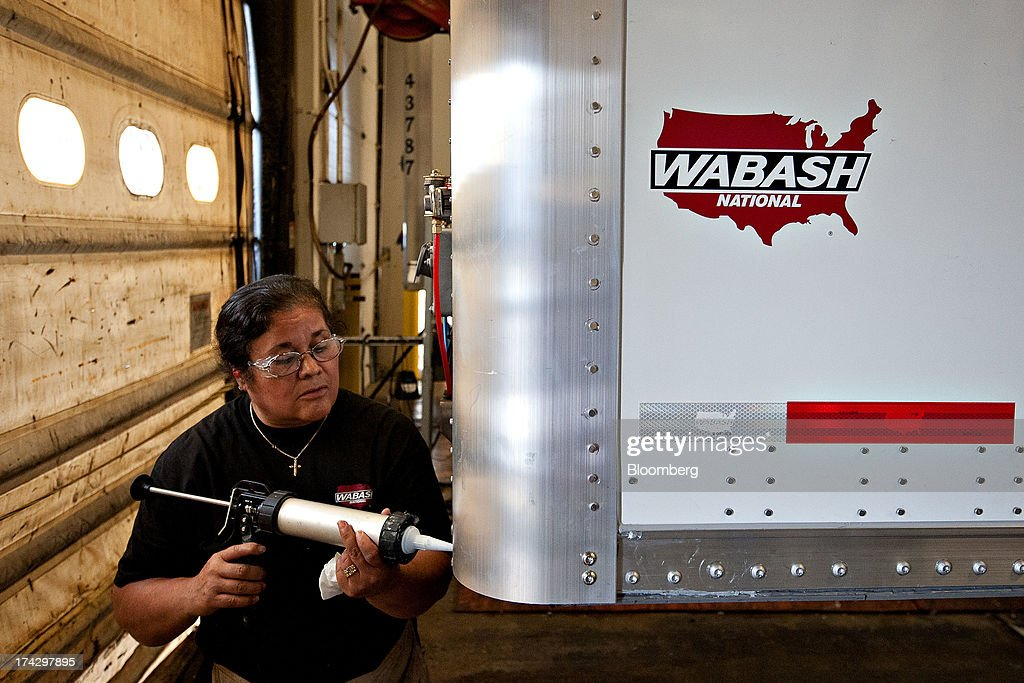 Employee Maria Herrera seals a seam on a semi trailer during assembly at the Wabash National Corp. facility in Lafayette, Indiana, U.S., on Monday, July 22, 2013. Wabash National Corp. is scheduled to release earnings figures on July 30. Photographer: Daniel Acker/Bloomberg via Getty Images