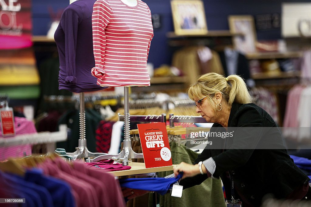 Employee Mary Exley organizes Lands' End Inc. apparel for sale at a Sears store during the Family and Friends evening sale inside the Del Amo shopping mall in Torrance, California, U.S., on Sunday, Nov. 11, 2012. Sears Holdings Corp., the retailer controlled by hedge-fund manager Edward Lampert, fell the most in more than 10 months on Nov. 16, after posting a wider third-quarter loss and its 23rd straight quarterly sales decline. Photographer: Patrick Fallon/Bloomberg via Getty Images