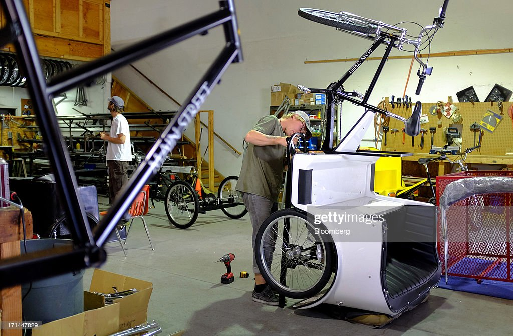 Employee Mike Mielke works on a pedicab at the Main Street Pedicabs Inc. manufacturing facility in Broomfield, Colorado, U.S., on Monday, June 24, 2013. The U.S. Census Bureau is scheduled to release durable goods figures on June 25. Photographer: Matthew Staver/Bloomberg via Getty Images