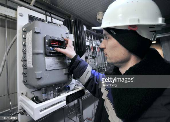 Employee Mikhail Bashlakov inspects instruments in the monitoring station at the gas compressor facility operated by OAO Gazprom in Sudzha Russia on...