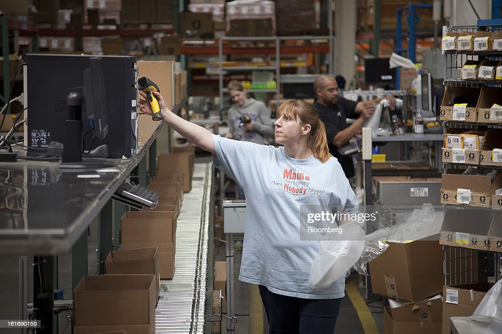 Employee Nichole Brown packs parts for customers in the warehouse at the Graco Inc. manufacturing facility in Minneapolis, Minnesota, U.S., on Tuesday, Feb. 5, 2013. Photographer: Ariana Lindquist/Bloomberg via Getty Images