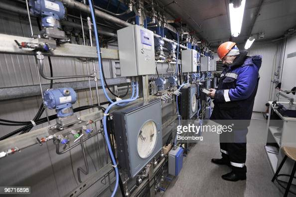 Employee Nikolai Konopla inspects instruments inside the monitoring station at the gas compressor facility operated by OAO Gazprom in Sudzha Russia...