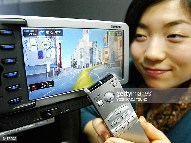 Employee of Japanese electronics giant Sony Sachiko Negishi displays the new HDD car navigation system 'NVXYZ777' which can display animated 3D CG...
