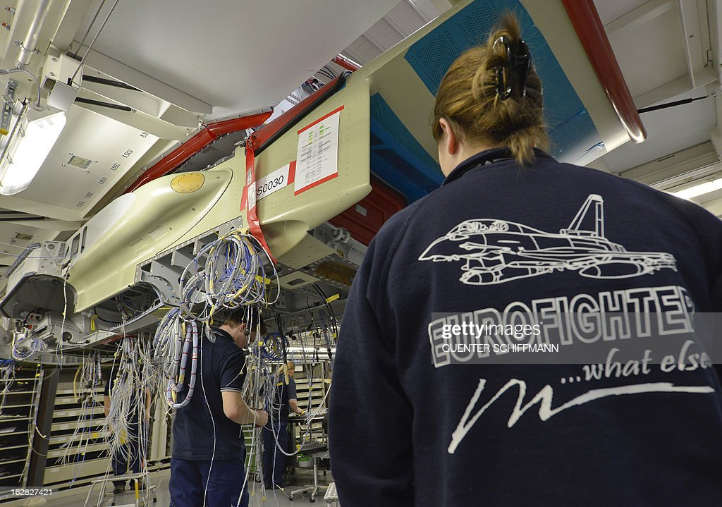 Employee of the EADS company Cassidian work on the assembling of an Eurofighter plane for the German Air Force at the Cassidian production line in Manching, southern Germany, on February 28, 2013. AFP PHOTO / GUENTER SCHIFFMANN