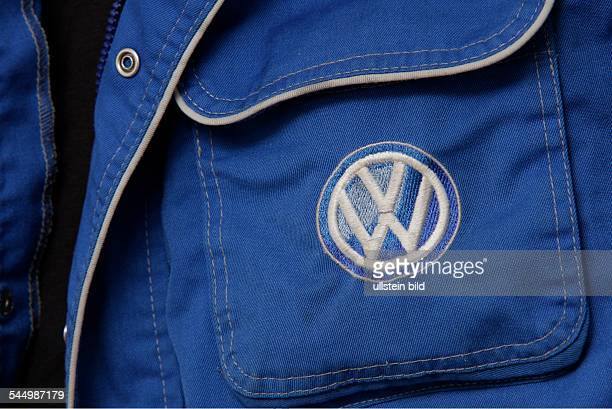 employee of Volkswagen overall VW emblem