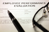 Someone filling out Employee Performance Evaluation.