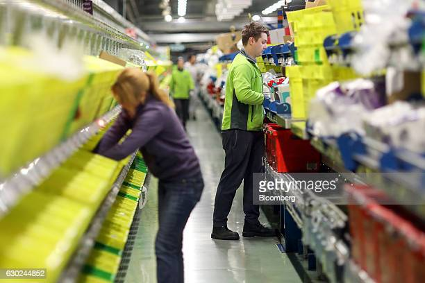 Employee pick customers orders at the Ocado Group Plc distribution centre in Dordon UK on Friday Dec 16 2016 Ocado provides home delivery of a wide...