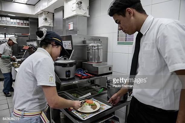 Employee prepares a meal for the employees at Alphaville McDonald's store Barueri Brazil