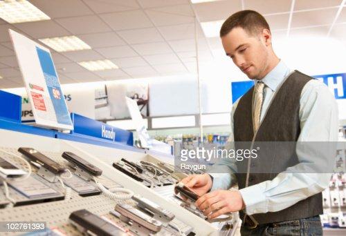 Employee preparing mobile phones : Stock Photo