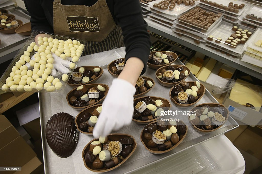 Employee Ramona Boehm packs chocolate Easter eggs at the production facility at Confiserie Felicitas chocolates maker on April 9, 2014 in Hornow, Germany. Easter is among the busiest times of year for the chocolatier, which produces Easter bunnies and eggs in a wide variety of sizes and styles. Founded by Belgian expats Goedele Matthyssen and Peter Bientsman the company will soon celebrate its 21st year.