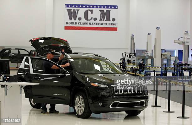 Employee Rick Sexton checks a Jeep Cherokee in the Metrology Lab at the Chrysler Group LLC Toledo Assembly Complex in Toledo Ohio US on Thursday July...