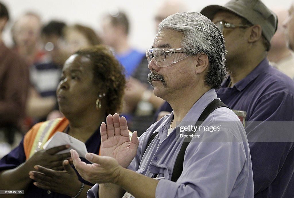 Employee Robert Mikwa applauds during an event at the General Motors Co. (GM) transmission plant in Warren, Michigan, U.S., on Friday, Oct. 21, 2011. General Motors said they will invest $325 million in tools and equipment to support production of future electric vehicle components, creating or retaining 418 jobs. Photographer: Jeff Kowalsky/Bloomberg via Getty Images