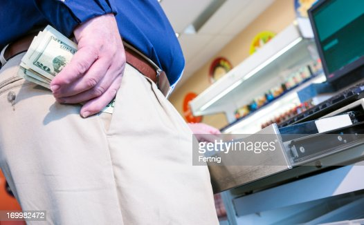 Employee stealing money from the cash register