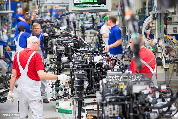 Employee work on the assembly line inside the Volkswagen AG factory in Wolfsburg Germany on Friday May 20 2016 Volkswagen AG agreed to raise German...