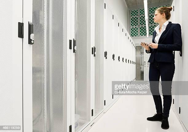 Employee working in data storage warehouse