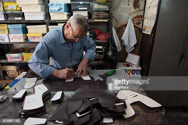 employee works on design a shoes in shoe factory in Nablus' old town in West Bank on May 31 2015 Nablus city northern of the Palestinian territories...