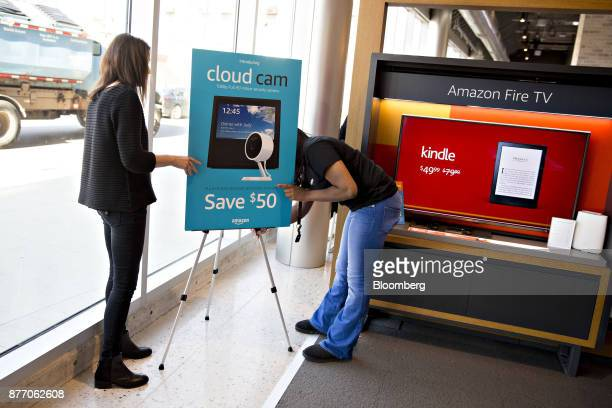 Employees adjust a sign displayed at an Amazoncom Inc PopUp store inside the Lakeview Whole Foods Market Inc store in Chicago Illinois US on Monday...