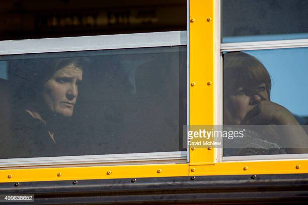 Employees and other people are evacuated by bus from the site of a mass shooting at the Inland Regional Center December 2 2015 in San Bernardino...