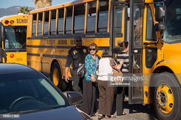Employees and other people are evacuated by bus from the site of a mass shooting on December 2 2015 in San Bernardino California Numerous deaths and...