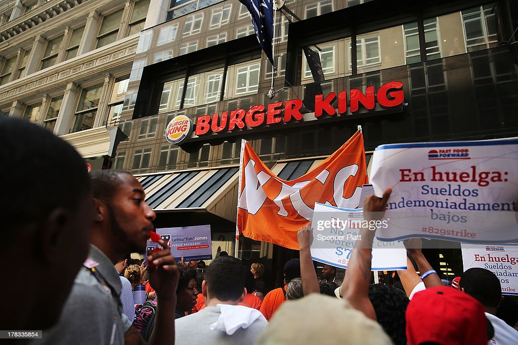 Employees and supporters demonstrate outside of a Wendy's and Burger King fast-food restaurants to demand higher pay and the right to form a union on August 29, 2013 in New York City. Across the country thousands of low-wage workers are expected to walk off their jobs Thursday at fast food establishments in several U.S. cities. Workers at KFC, Wendy's, Burger King, McDonald's and other restaurants are calling for a living wage of $15 an hour and the right to form a union without retaliation.