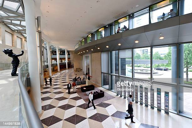 Employees and visitors move across the lobby inside ABN Amro Bank NV's headquarters in Amsterdam Netherlands on Monday May 21 2012 Rising popularity...