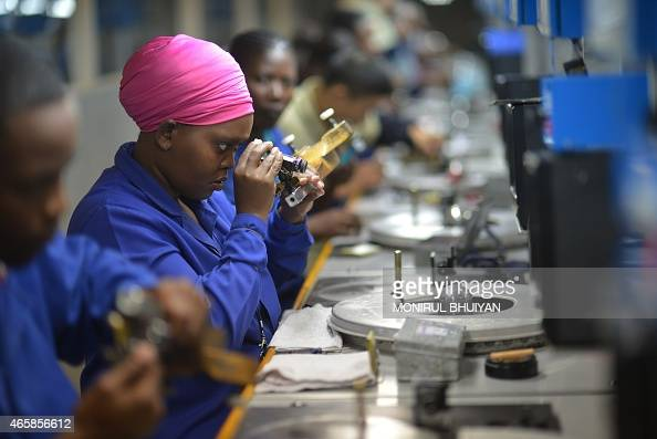 Employees are at work at a Diamond cutting and polishing company in Gaborone Botswana on March 11 2015 AFP PHOTO/MONIRUL BHUIYAN